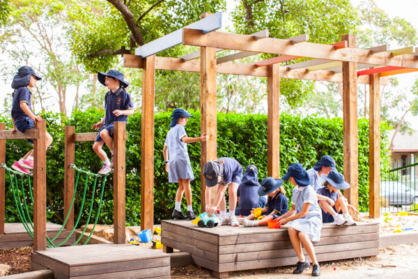 Students play on outdoor equipment
